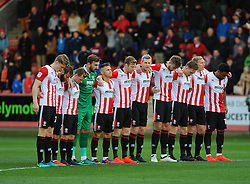 Cheltenham Town players stand for a minutes silence - Mandatory by-line: Nizaam Jones/JMP - 05/11/2016 - FOOTBALL - LCI Rail Stadium - Cheltenham, England - Cheltenham Town v Crewe Alexandra - Emirates FA Cup first round