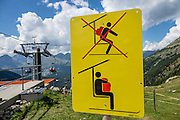 "A loading sign advises holding backpack in your in your lap, at Alp Languard chairlift above Pontresina in Upper Engadine, in Graubünden (Grisons) canton, Switzerland, the Alps, Europe. The Swiss valley of Engadine translates as the ""garden of the En (or Inn) River"" (Engadin in German, Engiadina in Romansh, Engadina in Italian)."