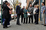 Connecticut Democratic gubernatorial candidate and former Stamford Mayor Dan Malloy, third from left, talks to residents and business owners during a tour of the Parkville section of Hartford, Conn., Wednesday, Oct. 27, 2010. Malloy faces Republican Tom Foley in the Nov. 2 election. (AP Photo/Jessica Hill)