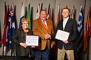Claremore native Logan Tacker (right), an agribusiness major, receives an Oklahoma State University Win and Kay Ingersoll Scholarship from Win and Kay Ingersoll (left) at the university's recent College of Agricultural Sciences and Natural Resources Scholarships and Awards Banquet. The scholarship is part of more than $1.4 million in scholarships and awards presented to CASNR students for the 2016-2017 academic year. (Photo by Todd Johnson)