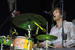 © Licensed to London News Pictures . 21/07/2013 . Suffolk , UK . Drummer Christopher Bear of Grizzly Bears performing on the Obelisk Stage . The Latitude music and culture festival in Henham Park , Southwold . Photo credit : Joel Goodman/LNP