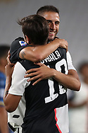 Juventus's Argentinian striker Paulo Dybala celebrates with Juventus's Uruguayan midfielder Rodrigo Bentancur during the Serie A match at Allianz Stadium, Turin. Picture date: 26th June 2020. Picture credit should read: Jonathan Moscrop/Sportimage