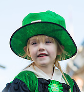 A little girl watches the procession on Piccadilly during the St Patrick's Day Parade in Westminster, London.<br /> Picture by Paul Davey/Focus Images Ltd +447966 016296<br /> 13/03/2016