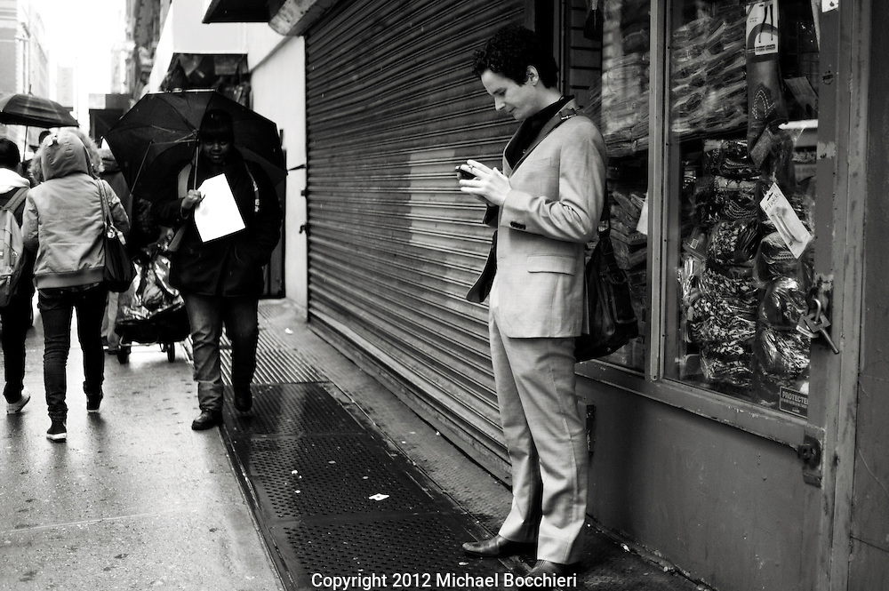 NEW YORK, NY - February 16:  A man in a suit looks at his phone on February 16, 2012 in NEW YORK, NY.  (Photo by Michael Bocchieri/Bocchieri Archive)