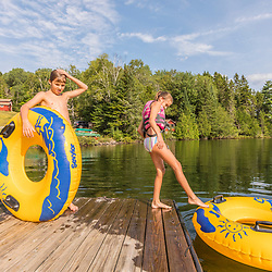 Kids on the dock in Island Pond at Red River Camps in Aroostook County, Maine. Deboullie Public Reserve Land.