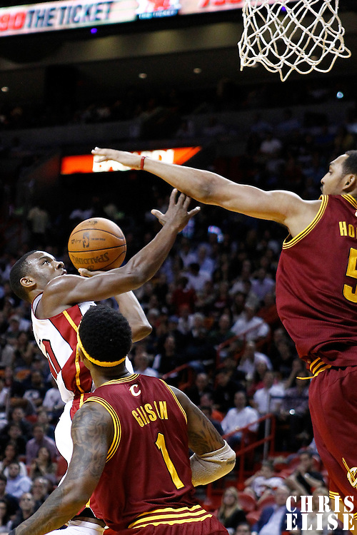 24 January 2012: Miami Heat point guard Norris Cole (30) goes for the lay up during the Miami Heat 92-85 victory over the Cleveland Cavaliers at the AmericanAirlines Arena, Miami, Florida, USA.
