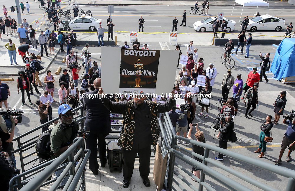 Najee Ali holds a sign during a rally and march circle to protest the all-white slate of Oscar acting nominees and calling for more diversity in the entertainment industry, Sunday Feb. 28, 2016 in Los Angeles.(Photo by Ringo Chiu/PHOTOFORMULA.com)<br /> <br /> Usage Notes: This content is intended for editorial use only. For other uses, additional clearances may be required.
