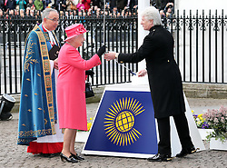 The Queen performs the breaking of the Commonwealth flag  as she arrives at the annual Commonwealth Observance at Westminster Abbey in London, Monday, 10th March 2014. Picture by Stephen Lock / i-Images