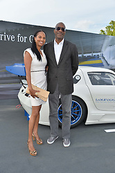 ED MOSES and his wife MICHELLE at the Laureus Polo held at Ham Polo Club, Ham, Richmond, Surrey on 18th June 2015.