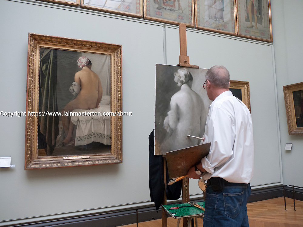 Artist copying a painting at the Louvre museum in Paris France