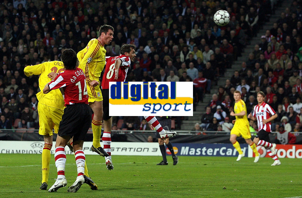 Photo: Paul Thomas.<br />PSV Eindhoven v Liverpool. UEFA Champions League, Quarter Final, 1st Leg. 03/04/2007.<br /><br />Jamie Carragher (3rd L) of Liverpool comes close to scoring with this header.