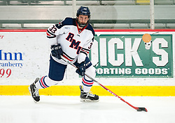 March 12 2016: Robert Morris Colonials forward Alex Dagnal (33) looks to make a pass during the second period in game two of the Atlantic Hockey quarterfinals series between the Bentley Falcons and the Robert Morris Colonials at the 84 Lumber Arena in Neville Island, Pennsylvania (Photo by Justin Berl)
