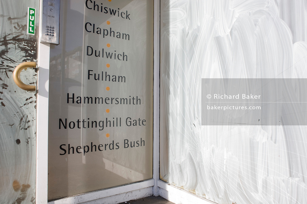 The closed door and smeared emulsion paint on the window of estate agent Bushells, Streatham, a victim of the UK recession.