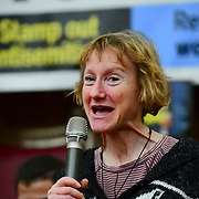 Speaker at the  Stand Up To Racism  hosts Challenging the hostile environment and racism will democracy breaking its own law with Jeremy Corbyn labelling Brexit European  stealing job, Migrant rapist, Muslim terrorists, Muslim Grooming, African/Black is a criminal or rapist, Chinese the #coronavirus and let the refugees drown at Islington Town Hall on 6 March 2020, London, UK.