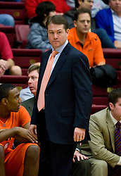 December 16, 2009; Stanford, CA, USA;  Oklahoma State Cowboys head coach Travis Ford  during the first half against the Stanford Cardinal at Maples Pavilion.  Oklahoma State defeated Stanford 71-70.