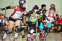 Roller Derby: Small Town Outlaws vs Lansing Corruption at July 21 bout in Kalkaska.