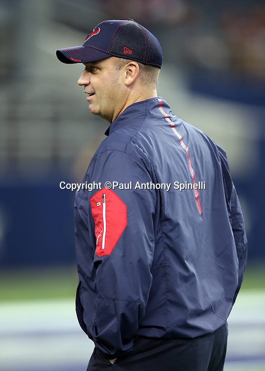 Houston Texans head coach Bill O'Brien has a conversation during pregame warmups before the 2015 NFL preseason football game against the Dallas Cowboys on Thursday, Sept. 3, 2015 in Arlington, Texas. The Cowboys won the game 21-14. (©Paul Anthony Spinelli)