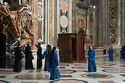 A group of visiting nuns and priests tour the Vatican