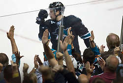 October 8, 2009; San Jose, CA, USA; San Jose Sharks right wing Dany Heatley (15) celebrates after scoring his third goal of the game against the Columbus Blue Jackets during the the third period at HP Pavilion. Mandatory Credit: Jason O. Watson / US PRESSWIRE