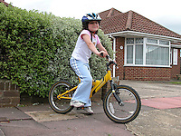 Young girl with safety helmet off for a bicycle ride.