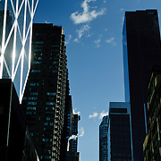 New York City buildings in a blue wold sky.