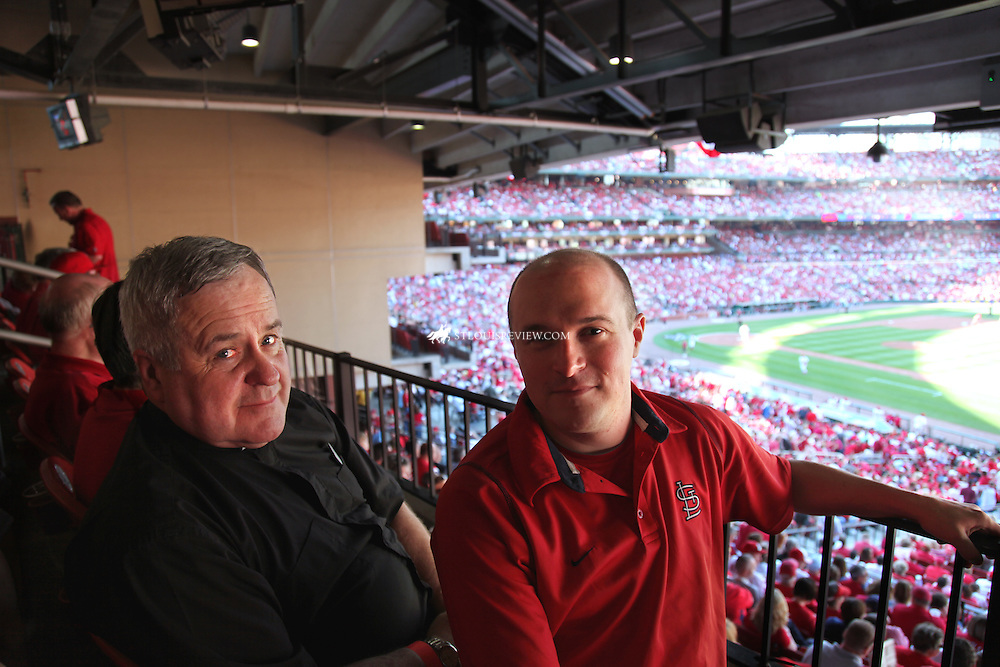 Archbishop Robert J. Carlson and Father Jim Theby, associate pastor at Assumption Parish in O'Fallon, attended the Cardinals' home opener April 12 at Busch Stadium.