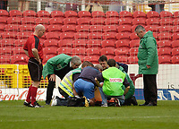 Photo: Leigh Quinnell.<br /> Swindon Town v Grimsby Town. Coca Cola League 2. 14/10/2006. Swindon goalkeeper Peter Brezovan is treated for a bad injury on the pitch.