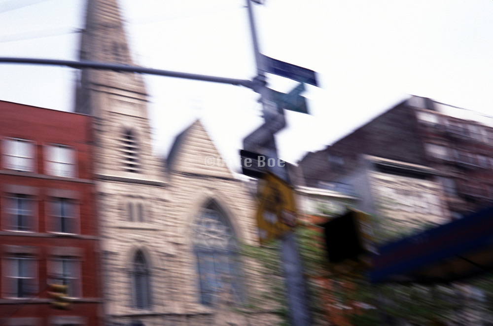 street signs in front of church