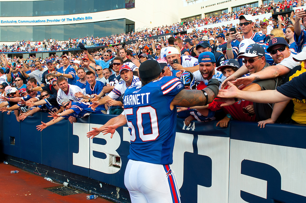 ORCHARD PARK, NY - SEPTEMBER 25: Nick Barnett #50 of the Buffalo Bills celebrates with fans after defeating the New England Patriots at Ralph Wilson Stadium on September 25, 2011 in Orchard Park, New York. The Bills defeated the Patriots 37 to 34. (Photo by Rob Tringali) *** Local Caption *** Nick Barnett
