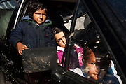 Girls wait in their family's car as city workers pack belongings. The Belville camp in New Belgrade on the morning of its destruction by the Belgrade city government.