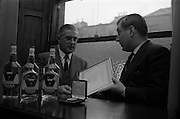 20/02/1964<br /> 02/20/1964<br /> 20 February 1964<br /> Presentation of World Wines and Liquor Olympics award to John Power and Son Ltd at the John's Lane Distillery. The prize was awarded for their Sarotov Vodka which received the Premier Award in its Category in the World Wines and Liquor Olympics.<br /> Picture shows M. andre L. de Vogelaere  (right), Counsellor of the Belgian Embassy, who presented the award, chatting with Mr P.A. Leavy, Sales Manager John Power and Son Ltd. after the presentation.