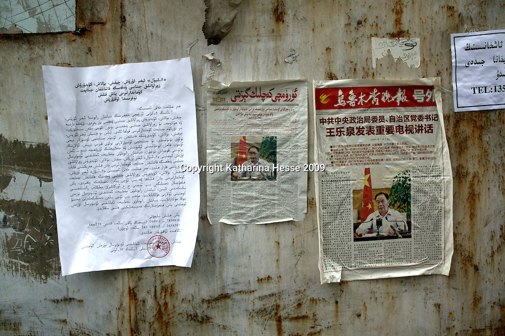 URUMQI, JULY-15 : newspaper clips explaining Wang Lequan's crackdown policy , are seen on the walls near the Xiangyang Po district.  Wang is the Communist Party Secretary of Xinjiang .