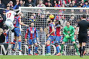 Mile Jedinak (15) of Crystal Palace heads the ball during the Barclays Premier League match between Crystal Palace and Liverpool at Selhurst Park, London, England on 6 March 2016. Photo by Phil Duncan.