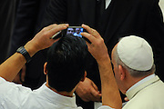 Pope Francis has met faithful during the general hearing of wednesday in Pope Paul VI Hall.<br /> &copy;Giuseppe Giglia