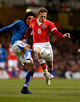 Photo: Leigh Quinnell.<br /> Wales v Paraguay. International Friendly. 01/03/2006. Wales' Craig Bellamy looks to pass Paraguays Denis Caniza.