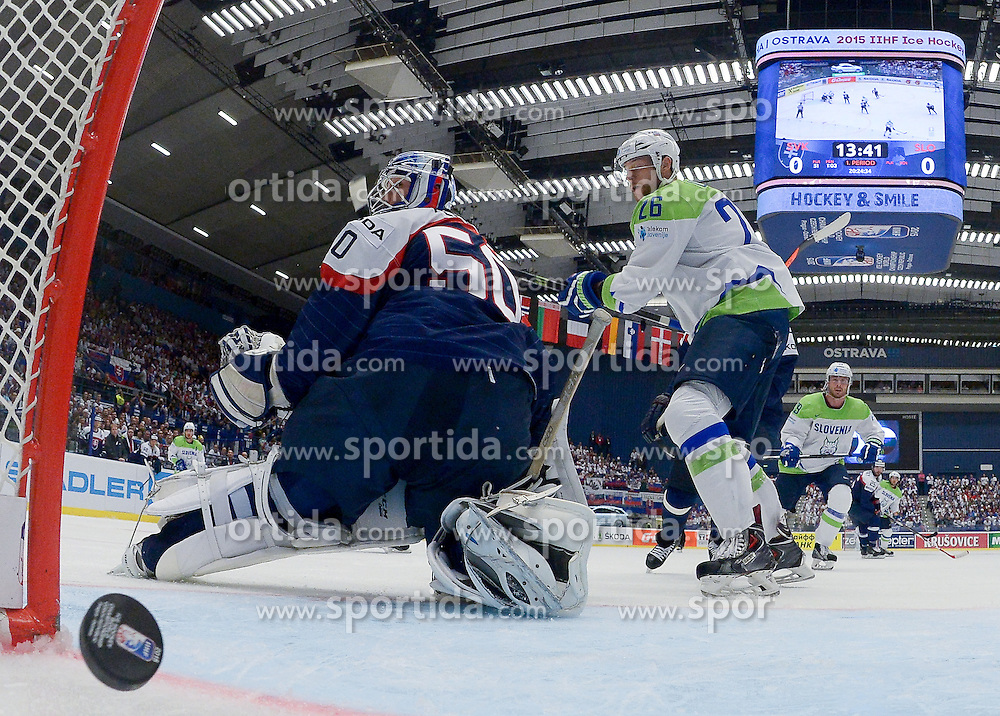 Jan Urbas of Slovenia scores against Jan Laco of Slovakia during Ice Hockey match between Slovakia and Slovenia at Day 5 in Group B of 2015 IIHF World Championship, on May 5, 2015 in CEZ Arena, Ostrava, Czech Republic. Photo by Vid Ponikvar / Sportida