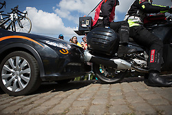 A race official's motobike rolls back on the steepest part of the Paterberg and slowly crashes into the Wiggle Hi5 Cycling Team car during the Ronde Van Vlaanderen - a 153.2 km road race, starting and finishing in Oudenaarde on April 2, 2017, in East Flanders, Belgium.