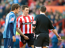 SHEFFIELD, ENGLAND - Saturday, March 1, 2008: Charlton Athletic's Greg Halford and Sheffield United's Chris Morgan are spoken to by the referee during the League Championship match at Bramall Lane. (Photo by David Rawcliffe/Propaganda)