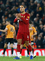 Football - 2019 / 2020 Premier League - Liverpool vs. Wolverhampton Wanderers<br /> <br /> Virgil van Dijk of Liverpool appplauds the Kop at the final whistle, at Anfield.<br /> <br /> COLORSPORT/ALAN MARTIN