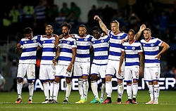Queens Park Rangers players look relieved after winning on penalties against Swindon Town - Mandatory by-line: Robbie Stephenson/JMP - 10/08/2016 - FOOTBALL - Loftus Road - London, England - Queens Park Rangers v Swindon Town - EFL League Cup