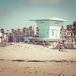 Huntington Beach Lifeguard Tower #5 retro picture with downtown Huntington Beach in the background. Photo has 1950's / 1960's nostalgic tone applied. Huntington Beach is a seaside beach city in Orange County California and is also known as Surf City USA. Image Copyright © Paul Velgos All Rights Reserved.