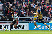 Sunderland's Striker Jermain Defoe (18) is chased by Arsenal midfielder Aaron Ramsey (16) during the Barclays Premier League match between Sunderland and Arsenal at the Stadium Of Light, Sunderland, England on 24 April 2016. Photo by George Ledger.
