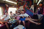 American honeymooners having fun at the Dreamtime Lounge of the Ghan, graced by Aboriginee wall paintings.