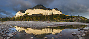 Sunrise illuminates Mount Kidd and reflects in Kananaskis River, in the Kananaskis Range of the Canadian Rockies, Alberta. Walk the Mt Kidd Interpretive Trail from Mt Kidd RV Park in Kananaskis Country, which is a park system west of Calgary. This panorama was stitched from 9 overlapping photos.