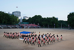 © Licensed to London News Pictures. LONDON, UK  08/06/11. .The flutes and drums of the Guards Division flank the podium as the enter the Horse Guards Parade on the opening night of the Beating the Retreat ceremony.  This year the opening night of Beating the Retreat took place with the American Ambassador receiving the salute. The traditional parade, involving all of the bands of the Household Division of the British Army, dates back to times when, after a day's battle, troops would retreat for the night.  Please see special instructions for usage rates. Photo credit should read Matt Cetti-Roberts/LNP