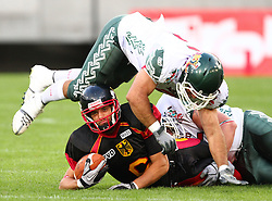 08.07.2011, Tivoli Stadion, Innsbruck, AUT, American Football WM 2011, Group A, Germany (GER) vs Mexico (MEX), im Bild Pascal Maier (Germany, #6, WR) lay on the field after the tackle from Montembruck Alberto (Mexico, #15, LB) and Valdez Jorge enrique (Mexico, #5, LB) jumps over him // during the American Football World Championship 2011 Group A game, Germany vs Mexico, at Tivoli Stadion, Innsbruck, 2011-07-08, EXPA Pictures © 2011, PhotoCredit: EXPA/ T. Haumer