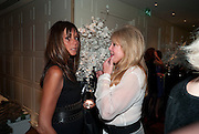 DEBBIE VON BISMARCK; PATTI BOYD, Book launch party for the paperback of Nicky Haslam's book 'Sheer Opulence', at The Westbury Hotel. London. 21 April 2010