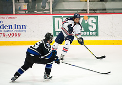 March 11 2016: Robert Morris Colonials forward Greg Gibson (16) attempts to make a pass while being defended by Bentley Falcons forward Max French (16) during the first period in game one of the Atlantic Hockey quarterfinals series between the Bentley Falcons and the Robert Morris Colonials at the 84 Lumber Arena in Neville Island, Pennsylvania (Photo by Justin Berl)