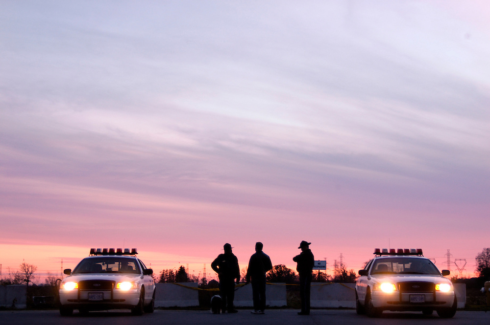 Police officers monitor the situation in Caledonia, Ontario after sunset on October 15, 2006. Photo by Daniel Hayduk