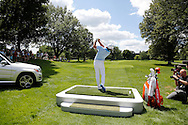Rickie Fowler hits his shot in a Mercedes-Benz par 3 contest for advertising and promotion event as an ambassador  <br /> at the PGA Championship 2013 USA Oak Hill CC Rochester<br /> Picture Credit:  Mark Newcombe / visionsingolf.com